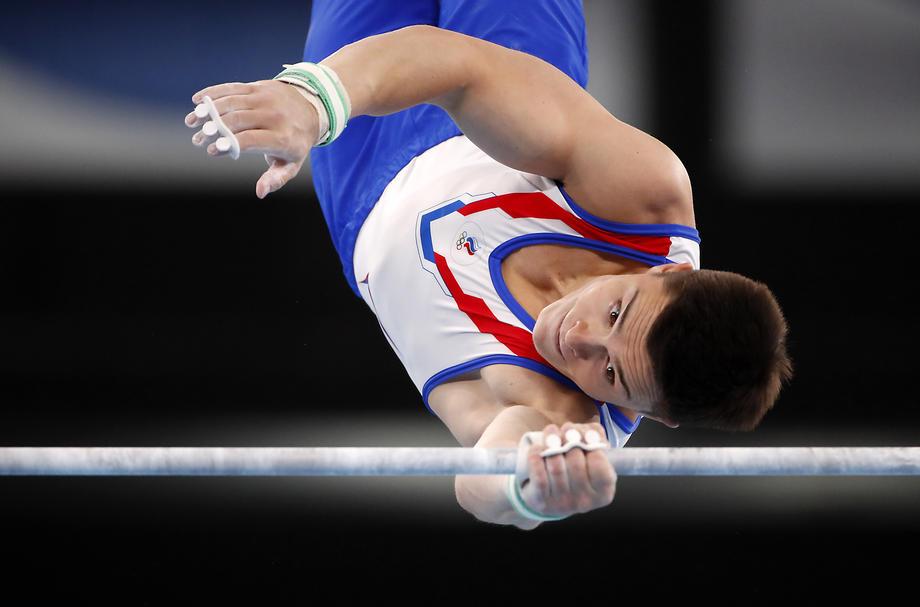 Российские гимнасты выиграли золото командного турнира Олимпиады-2020 - фото