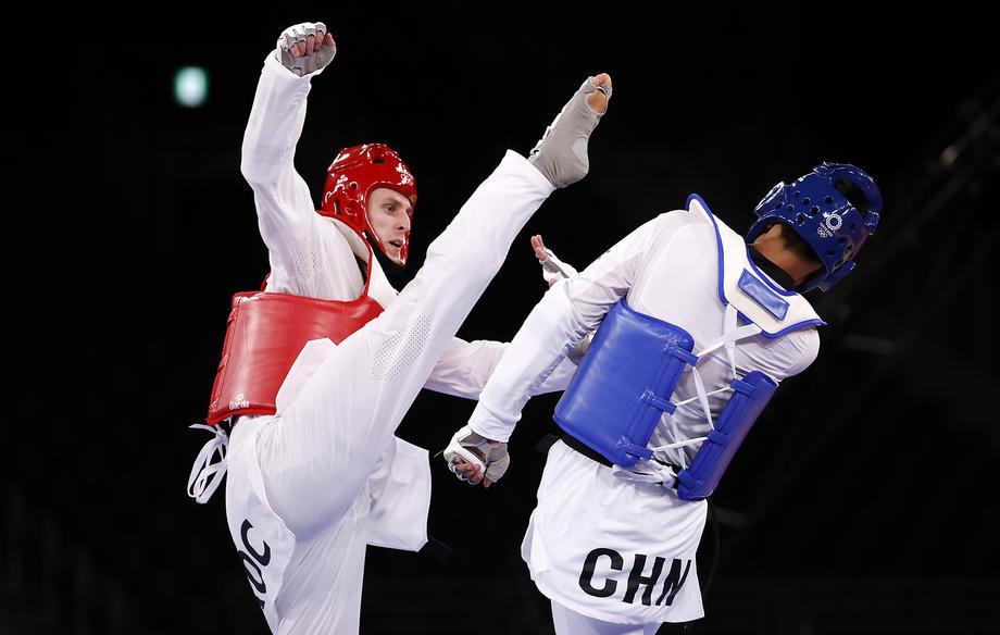 Россиянин Ларин завоевал золото Олимпиады-2020 в Токио - фото