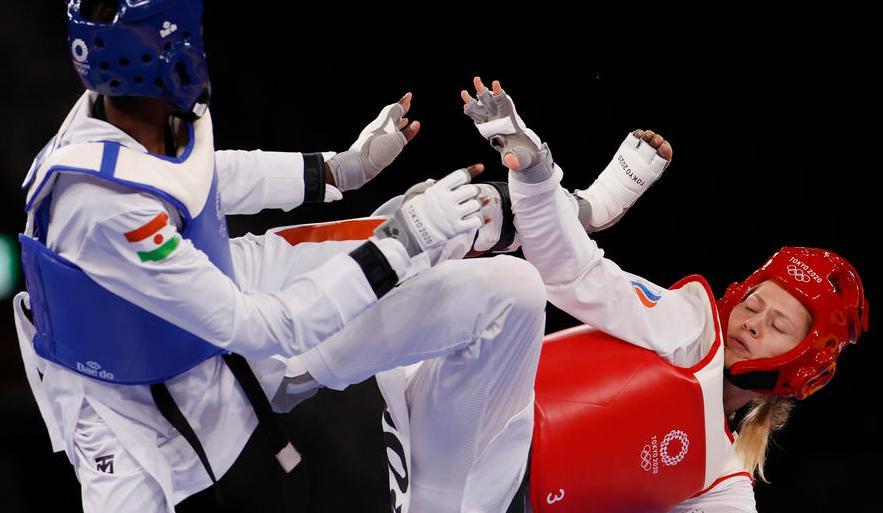 Минина выиграла серебряную медаль на Олимпиаде в Токио - фото