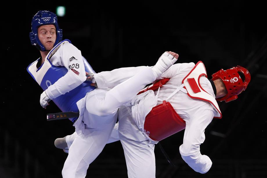 Россиянин Ларин вышел в финал олимпийского турнира  - фото